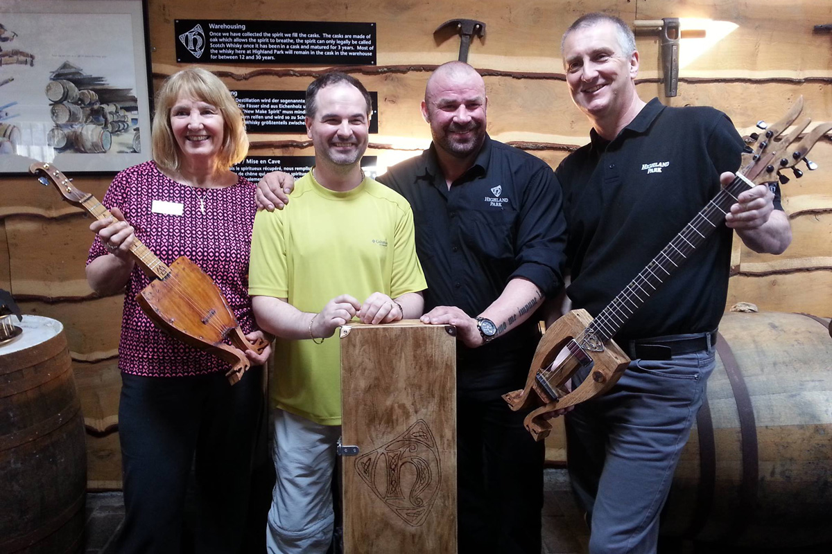 Jani, from Finland hands over his hand made guitar. Lovingly made from a Highland Park cask.