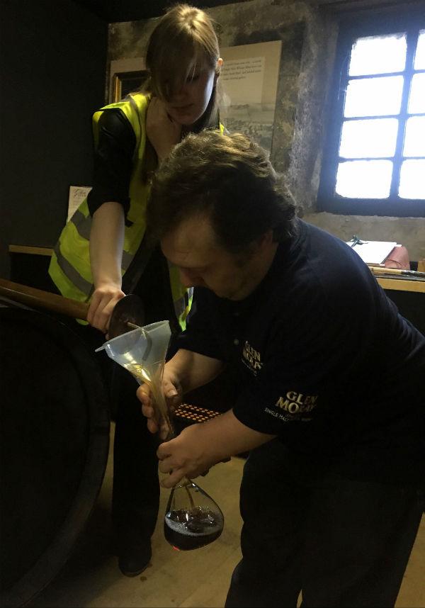 Anders filling his bottle at Glengarioch distillery Scotland