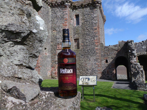 A bottle of Benriach whisky outside a castle in Perthshire
