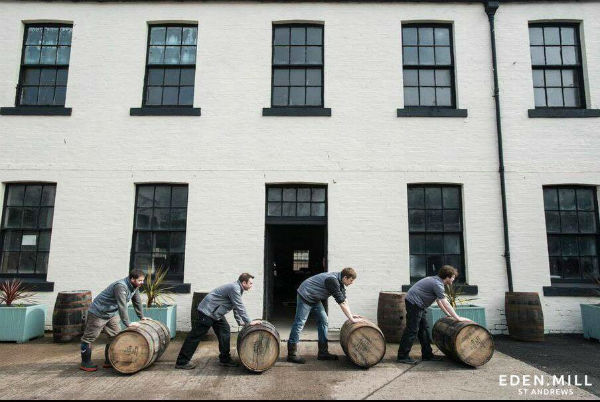 Guys rolling barrels outside Eden Mill (distillery and brewery) near St Andews