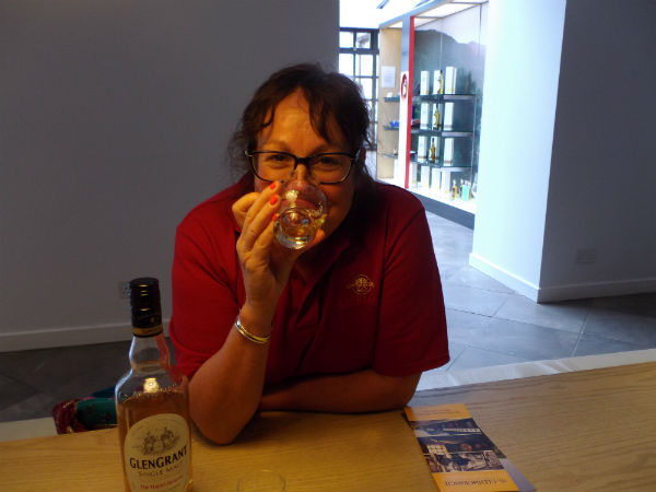 Liz sampling a Glen Grant dram