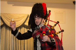 Spud the Piper with whisky toast plays at mcleanscotland distilled tour