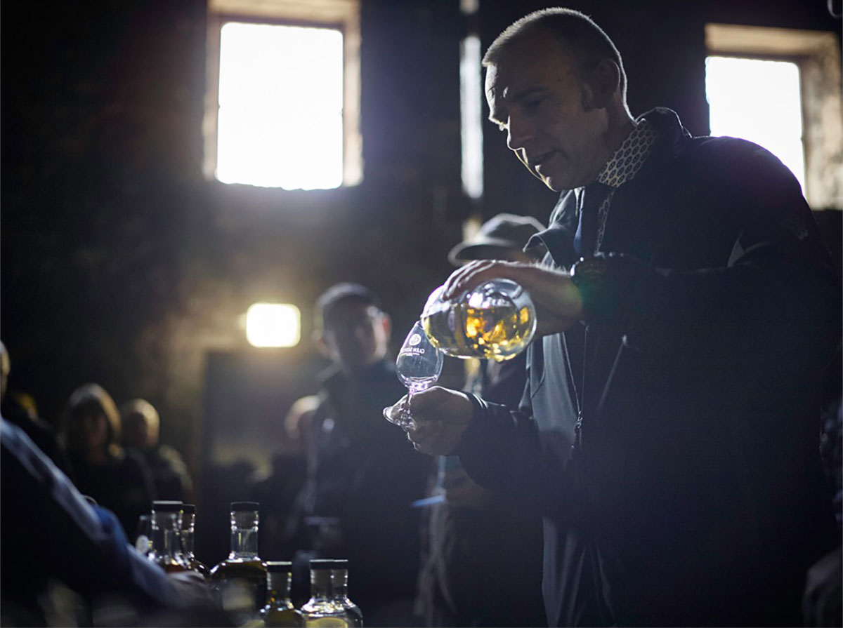 Iain McAlister, Distillery Manager at Glen Scotia Distiller;y pouring a dram