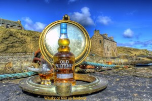 Old Pulteney Whisky bottle on the shore