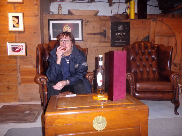 Liz sipping a dram in Speyside Distillery