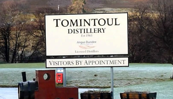 The road sign for Tomintoul Distillery, often hidden by snow in winter