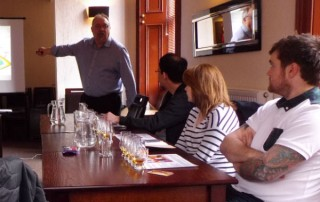 Vic Cameron taking a whisky school in Speyside