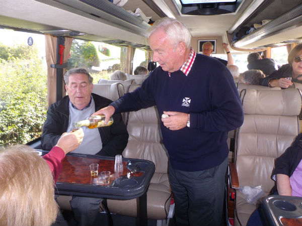 enjoying an Irish Whiskey or two on board our coach in Ireland