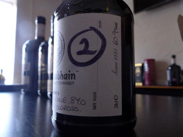 A bottle sitting inside Bunnahabhain Distillery, Islay