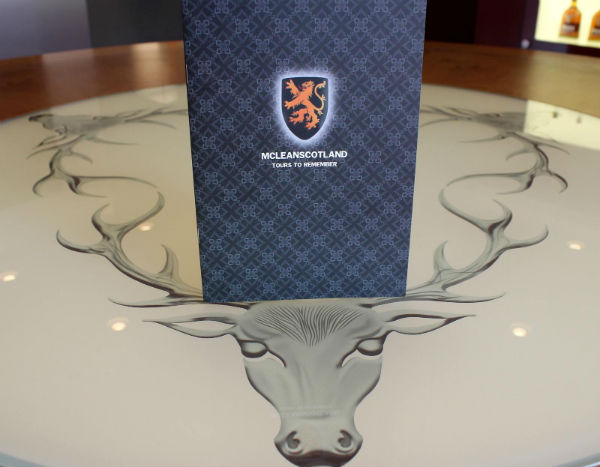 A whisky tour brochure sitting on a table inside Dalmore Distillery