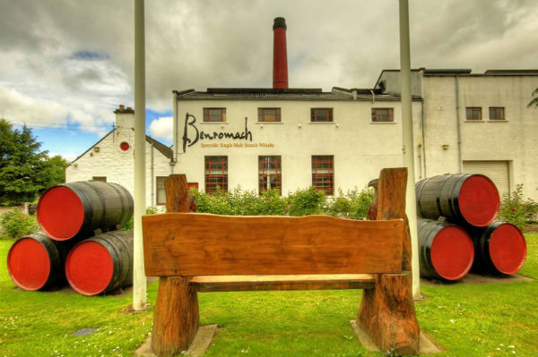 The lovely Benromach Distillery showing a bench outside